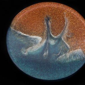 Sous-verre tricolore avec illusion de l'océan sur une plage